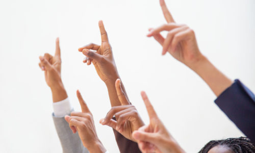 Business people raising hands and pointing index fingers up. Isolated arms on white background. Training concept